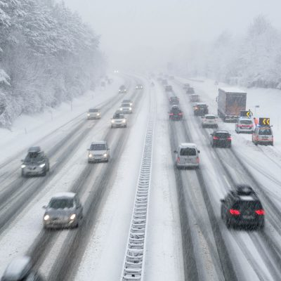 snow covered highway in austria with cars out of focus