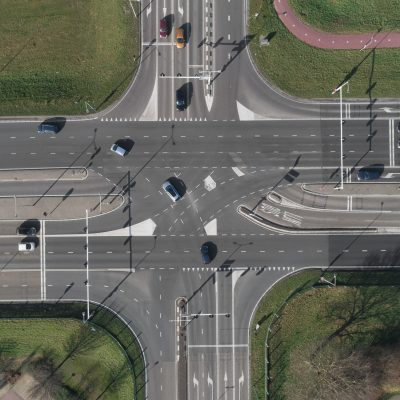 A Highway intersection with cars and traffic lights. Top view from drone