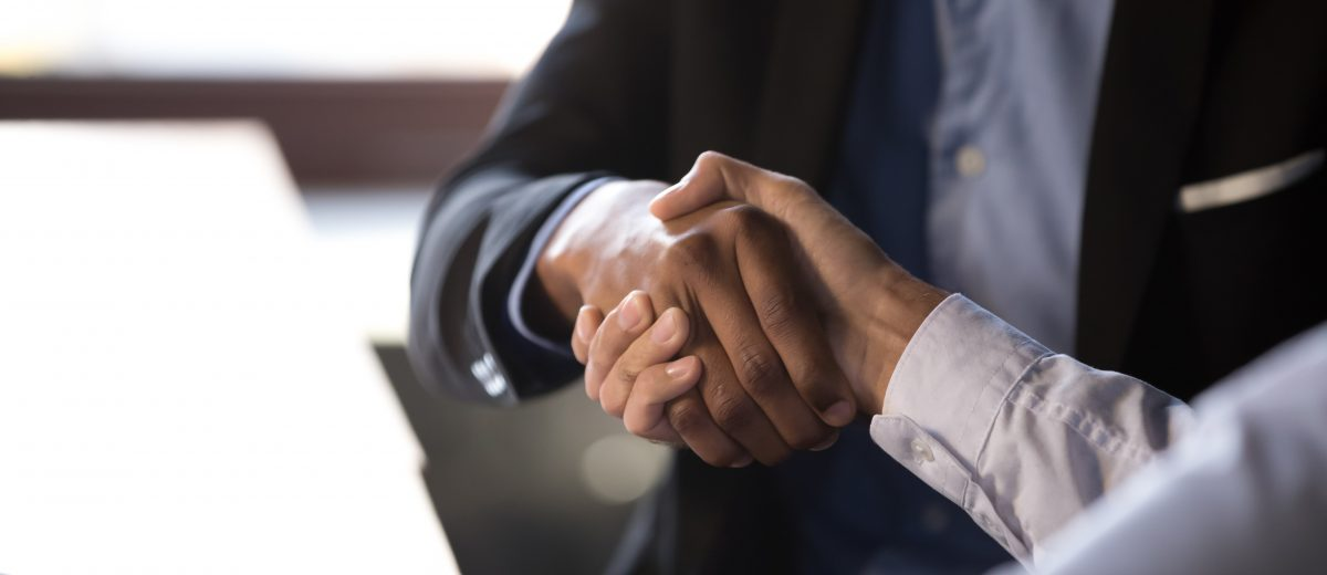 Close up african american businessman shaking hands with caucasian client. Handshake is symbol of starting finishing negotiations, successful teamwork signing contract, hiring human resource concept